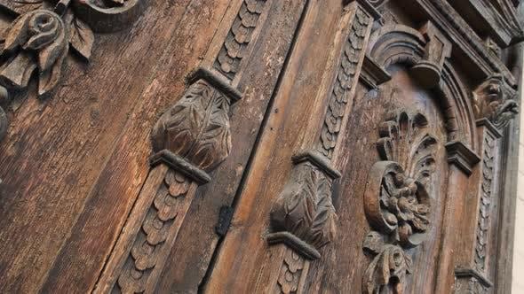 Slide Shot of an Old Wooden Door of a Beautiful Ancient Building. Wood Texture Doors. Close Up