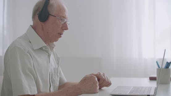 Aged Professor Is Explaining To Pupils Lecture, Communicating Online, By Webinar and Video Call
