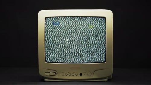 Old Retro Square Television Screen with Ripples and Interference on Black Background