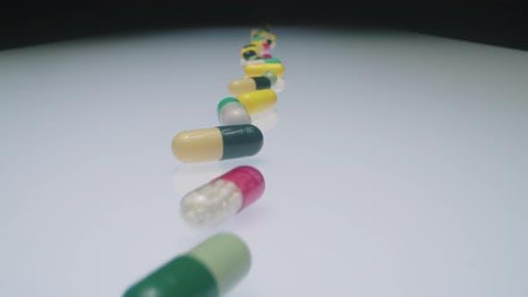 Thumbnail for Medicine Pills in Line Arrangement on Lab Desk