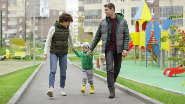 Thumbnail for Caucasian Couple and Young Son Going for Walk Outdoors