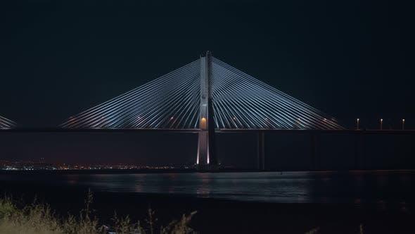 Thumbnail for City Waterfront and Vasco Da Gama Bridge at Night, Portugal