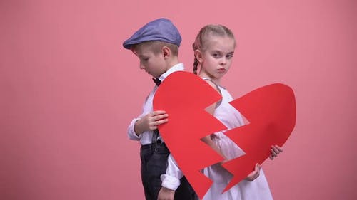 Sad Little Couple Holding Broken Pieces of Red Heart, Quarrelling, Brake Up