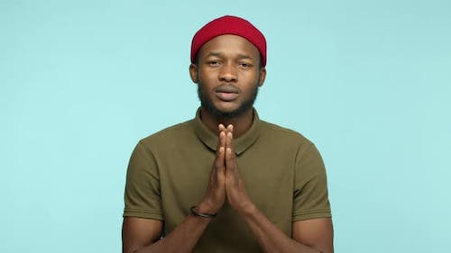 Slow Motion of Black Man 20s Years with Beard and Red Beanie Asking for Favour Say Please and