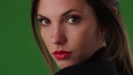 Thumbnail for Close up of beautiful woman with red lips looking over shoulder on greenscreen
