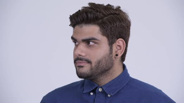 Cover Image for Young Bearded Indian Businessman Looking Bored and Tired