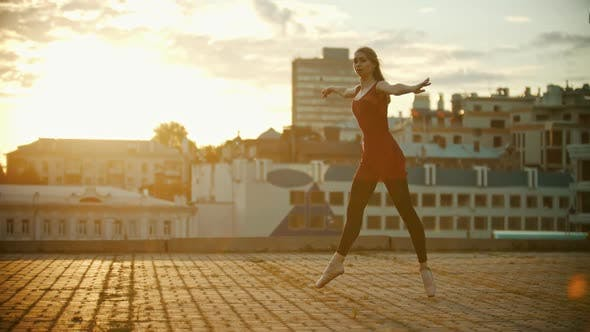 Thumbnail for Young Woman Ballerina Dancing on the Roof
