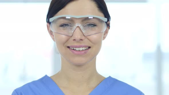 Thumbnail for Smiling Scientist, Doctor in Protective Glasses