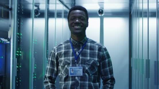Thumbnail for Smiling Black Man in Server Room