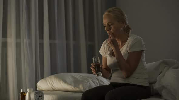Thumbnail for Mature Woman Suffering from Depression Taking Antidepressants to Calm Down