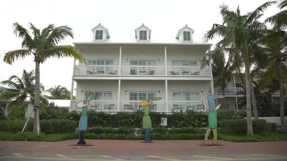 Thumbnail for Statues in front of a house