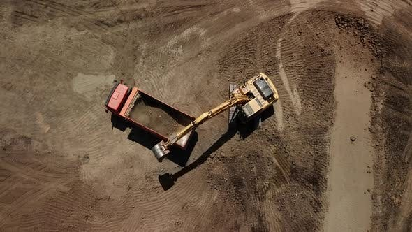 Thumbnail for Aerial View of Excavator Pours Sand Into the Truck