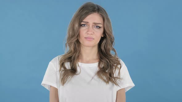 Thumbnail for Sad Upset Young Girl Isolated on Blue Background