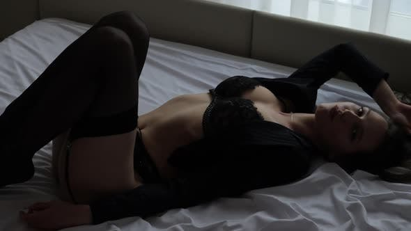 Sensual Woman in Erotic Lingerie on Bed
