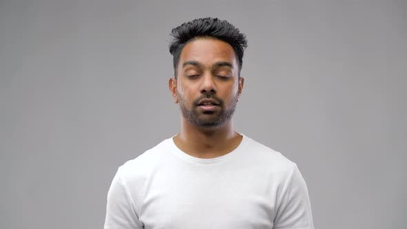 Thumbnail for Unhealthy Indian Man Sneezing and Blowing Nose 34