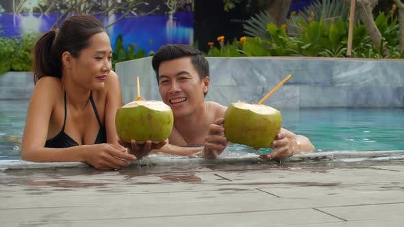 Thumbnail for Couple Relaxing in Pool
