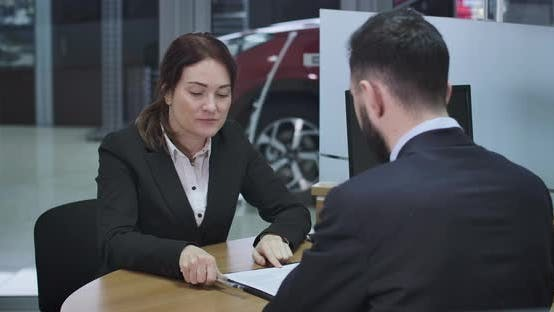 Thumbnail for Portrait of Confident Caucasian Woman Signing Sale and Purchase Agreement, Getting Car Keys From