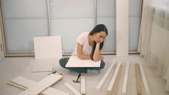 Thumbnail for Sad Woman Can't To Assemble Furniture
