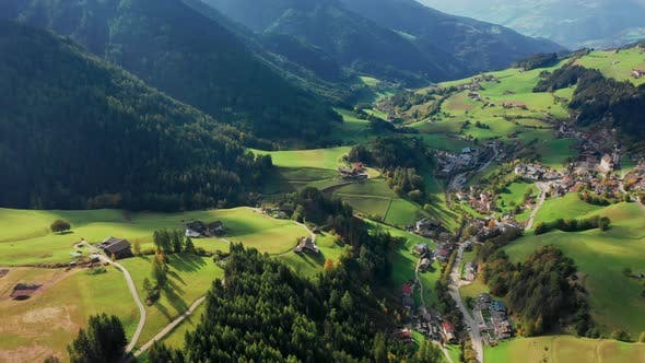 Thumbnail for Bird's-eye View of the Valley Among the Mountains in the Province of Bolzano, Dolomites. Autumn in