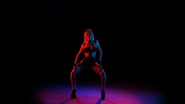 Thumbnail for Girl in Erotic Leather Underwear Dancing and Posing in Studio