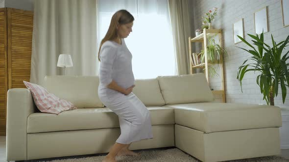 Pregnant Woman At Home Can't Get Out Of Sofa Feels Pain And Contraction