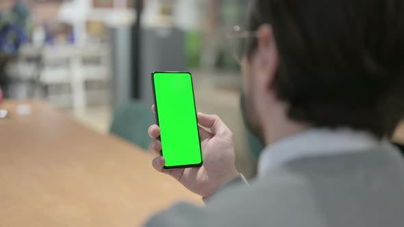 Man Using Smartphone with Green Screen