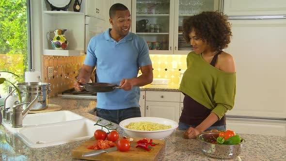 Thumbnail for Couple making pasta with sauce