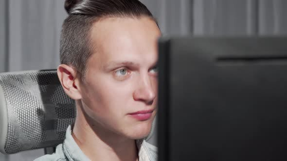 Thumbnail for Handsome Young Man Video Calling Using His Computer