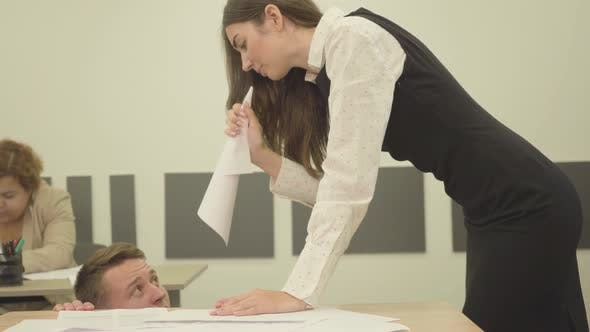 Portrait Nervous Angry Young Woman Folded Paper in the Form of a Horn and Yelling at the Man Who