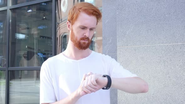 Cover Image for Beard Man Using Smartwatch
