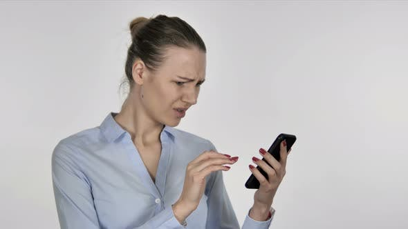Thumbnail for Young Businesswoman Reacting To Loss While Using Smartphone