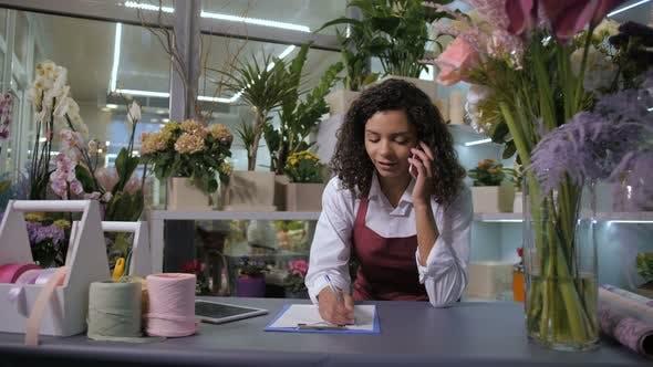 Thumbnail for Florist Taking Order on Phone in Flower Shop