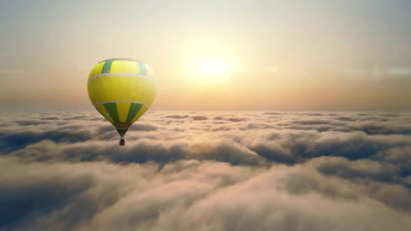 Aerial View Balloon Flying at Sunset Over the Clouds. Balloon Flight Above the Clouds. The Sun's