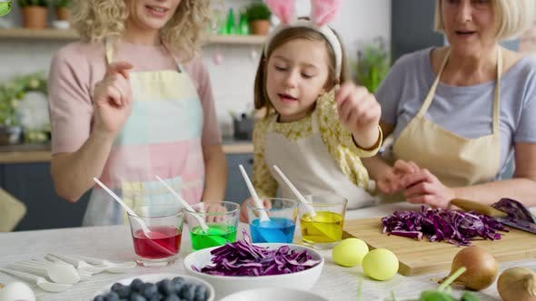 Video of girl showing natural egg dyes with her family, Shot with RED helium camera in 8K