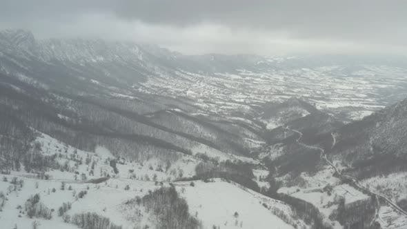 Thumbnail for Snow falling over the mountain in Eastern Sebia 4K aerial video