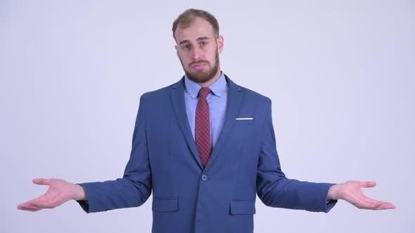 Confused Bearded Businessman Shrugging Shoulders