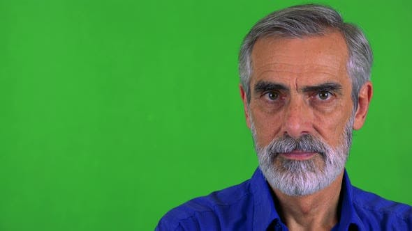 Thumbnail for Old Senior Man Looks To Camera with Serious Face - Green Screen - Studio