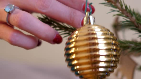Close Motion From Ball To Snowflake Hung on Christmas Tree