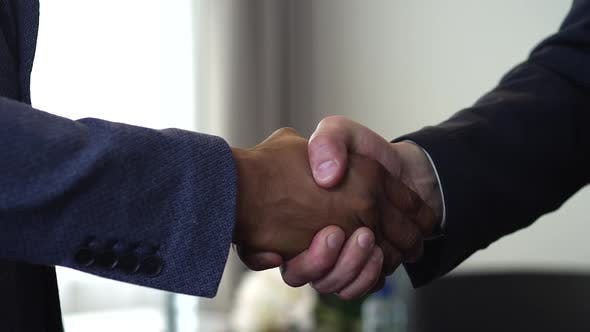 Cover Image for Handshake of Two Businessman - is the Completion of the Transaction