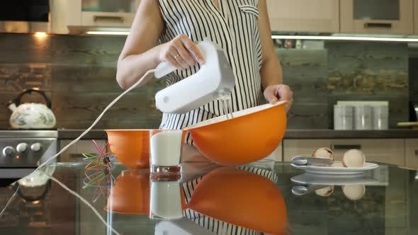 Thumbnail for Woman using electric mixer in the kitchen