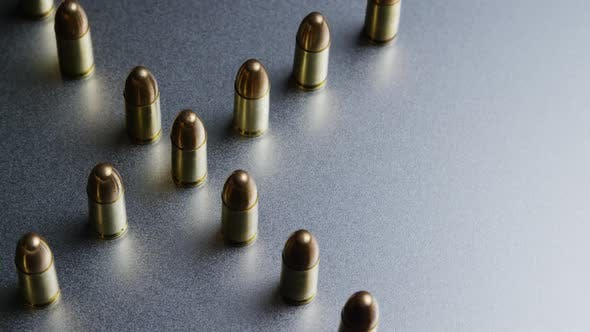 Thumbnail for Cinematic rotating shot of bullets on a metallic surface - BULLETS 042
