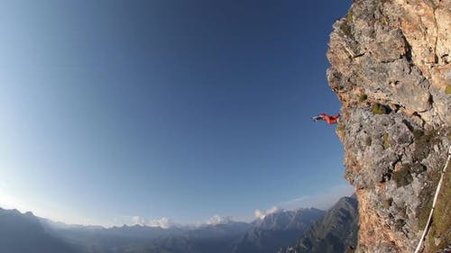 Extreme Parachute Jump From the Top of the Mountain. Base Jumping, Slow Motion