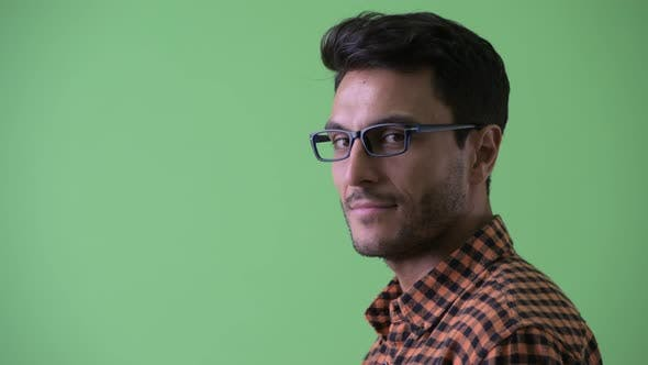 Thumbnail for Closeup Profile View of Happy Hispanic Hipster Man Looking at Camera