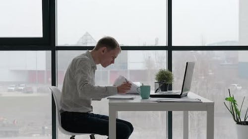 Concentrated Entrepreneur Working in the Office