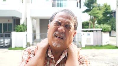 Asian elderly senior man in pain with neck injury
