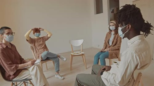 Multi-Ethnic Patients in Masks at Group Psychology Therapy