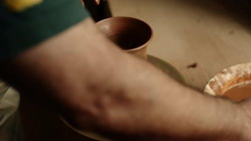 Ceramist Modeling Clay Jar in Pottery