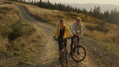 Couple Riding Sport Bikes in Landscape