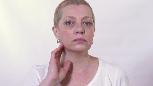 Thumbnail for Portrait Mature Woman Checking and Looking at Her Face Condition. Health, People and Beauty Concept