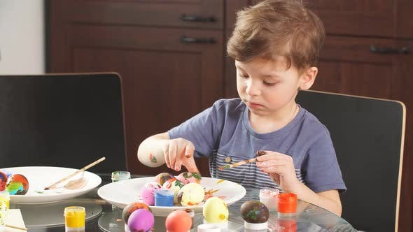 Thumbnail for Easter Celebration Concept. Happy Little Boy Decorating Easter Eggs for Holiday.